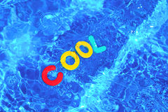 Word COOL floating in a swimming pool Royalty Free Stock Images