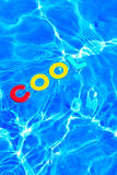 Word COOL floating in a swimming pool Stock Photo