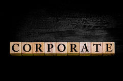 Word CORPORATE isolated on black background Stock Photography