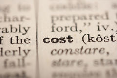 Word cost. From the old dictionary, a close up Royalty Free Stock Photos
