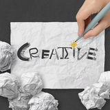 Word CREATIVE on crumpled paper Royalty Free Stock Photography