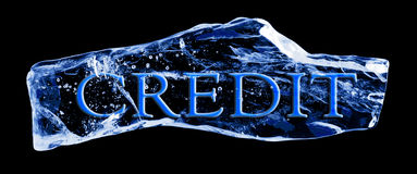 Word CREDIT frozen in the ice. On a black background Stock Photos