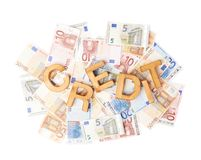 Word Credit over the pile of money Royalty Free Stock Images
