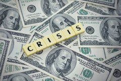 Word crisis on the american dollar money background Royalty Free Stock Photos