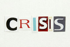 Word crisis cut from newspaper on white paper Stock Image