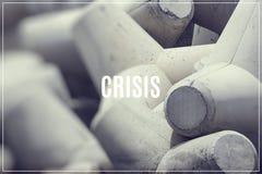 Word Crisis over breakwater concrete block. Word Crisis over breakwater concrete block Royalty Free Stock Images
