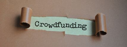 Word  `Crowdfunding` on paper. Word Crowdfunding typed on paper in the window Stock Photography