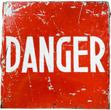 Word danger. Word  danger  on a red shield, the ultimate natural look Stock Photos