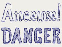 Word danger and attention Royalty Free Stock Photography