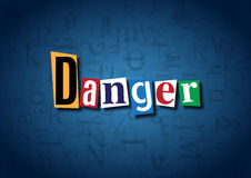 The word Danger made from cutout letters. On a blue background Stock Photography
