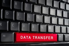 Word DATA TRANSFER on button of computer keyboard.Shallow DOF Royalty Free Stock Image