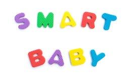 Word de bébé futé a formé par des puzzles d'alphabet Photographie stock libre de droits
