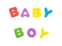 Word de bébé garçon formé par des puzzles d'alphabet Photographie stock