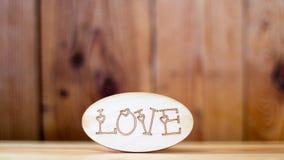 Word de l'espace de copie d'amour sur un fond en bois Photos stock