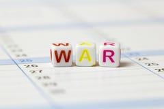 Word de la guerre présentée sur un calendrier Photographie stock