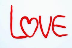 Word ` de Liefde ` maakt van rode Plasticine Royalty-vrije Stock Afbeelding