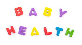 Word de santé de bébé a formé par des puzzles d'alphabet Photos libres de droits