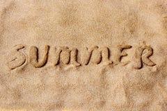 Word de zomer in het zand van een strand Royalty-vrije Stock Fotografie
