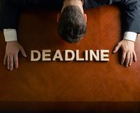 Word Deadline and devastated man composition Royalty Free Stock Image