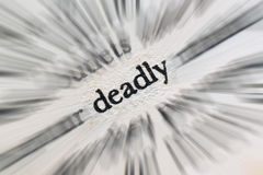 Word deadly in the book. Word Deadly printed in the book Stock Image
