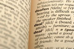 Word Deal in a dictionary Royalty Free Stock Photography