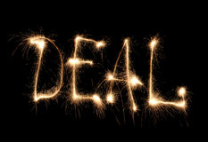 Word deal written sparkler Royalty Free Stock Photo