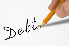 Word Debt on paper and broken pencil in hand Stock Photo