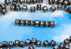 The word December. On the sky background Royalty Free Stock Photos