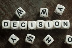 Word decision on toy cubes. Word decision on white toy cubes Royalty Free Stock Image