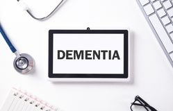 Word Dementia on tablet screen. Medical concept royalty free stock photo