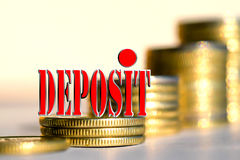 """The word """" Deposit """" in the background the columns of coins . The word """" Deposit """" in the background the columns of coins . The concept of financial Stock Image"""