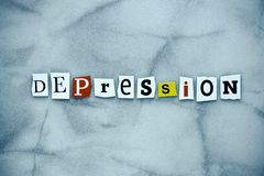 Word depression of cut letters on gray background. A word writing text showing depression. Abstract card with an inscription on gr stock photography