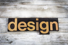 Design Letterpress Word on Wooden Background. The word `design` written in wooden letterpress type on a white washed old wooden boards background Royalty Free Stock Photography