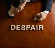 Word Despair and devastated man composition Royalty Free Stock Photo