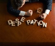 Word Desperation and devastated man composition royalty free stock image