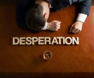 Word Desperation and devastated man composition stock image