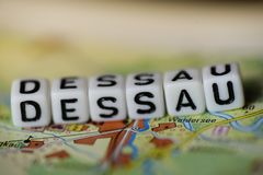 Word DESSAU formed by alphabet blocks on atlas map. Geography Royalty Free Stock Photos