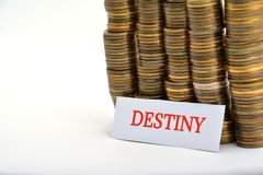 Word destiny with coins isolated on white. Background stock images