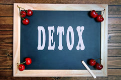 The word Detox on chalkboard Stock Photography