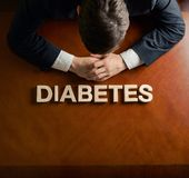 Word Diabetes and devastated man composition stock image