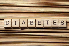 Word diabetes on wooden cubes at wood background