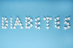 The word diabetes is written in sugar cubes stock photos