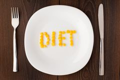 Word diet made of corn seeds on a plate Stock Image