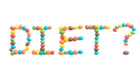 Word diet, made of multicolored candies isolated on white background royalty free stock photo