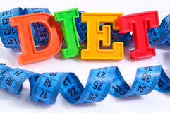 Word Diet written by colorful letters with blue measuring tape o Stock Images