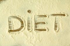 The word `DIET` written on flour Royalty Free Stock Photo