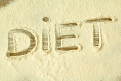 The word `DIET` written on flour Royalty Free Stock Images