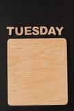Word Dinsdag met lege houten raad Royalty-vrije Stock Foto's