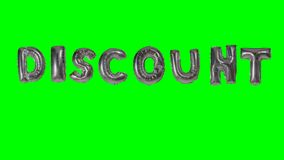 Word discount from helium silver balloon letters floating on green screen -. Word discount from helium silver balloon letters floating on green screen stock footage
