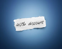 Word - 40% discount - on a scrap of white paper Stock Images